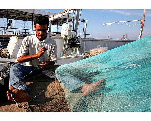 For some it is just a net, for him it is his living.Port of Tripoli,... (Tripoli, Lebanon)