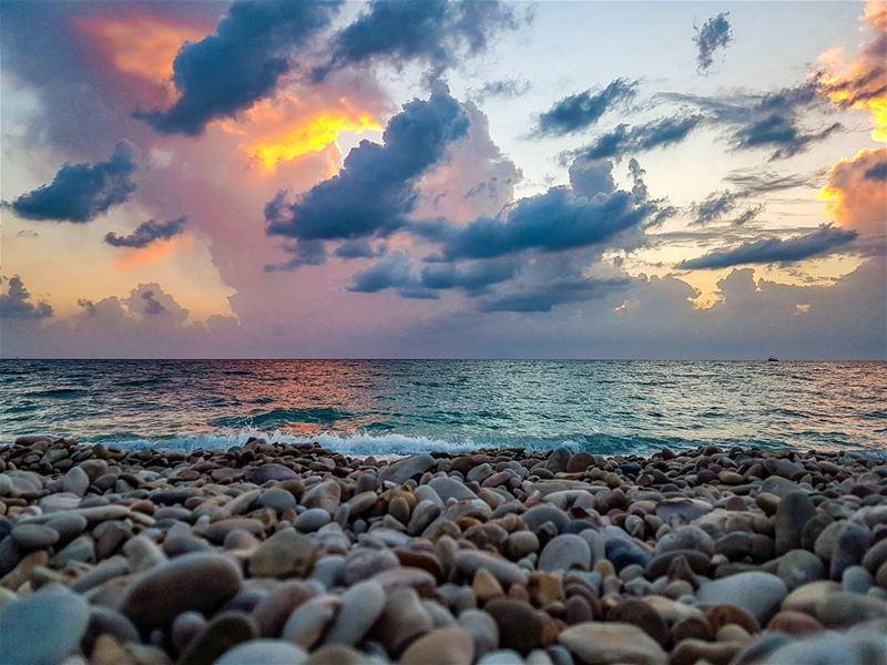 Seasons change, so do we sunset October rain storm stones waves ...