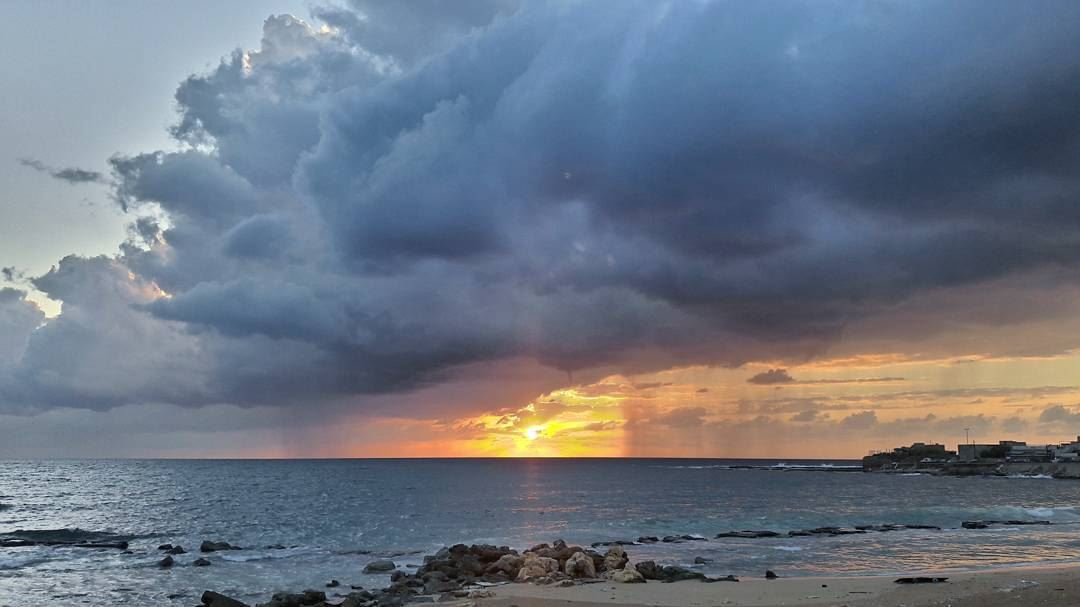 Raining on the right side but not on the left with a beautiful sunset🌅 ... (Al Mina', Liban-Nord, Lebanon)