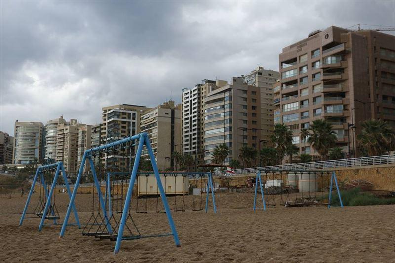 swinging a blue beachswing in a cloudyday... beach lebanon beirut ... (Ramlat Al Bayda', Beyrouth, Lebanon)