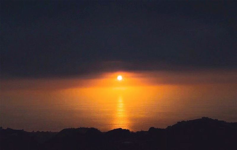 Let your eyes focus on the sun sinking down in the sea in the form of an... (Lebanon)