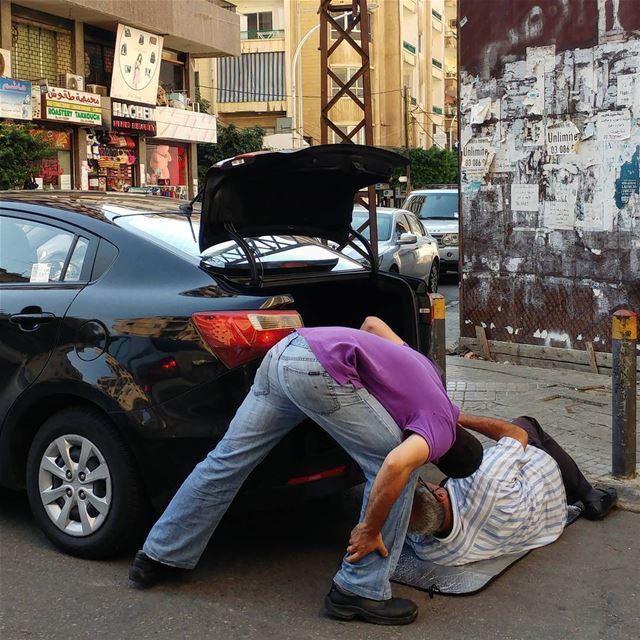 Improvised auto repair on the street in Beirut. Notice the sun shield is... (لبنان بيروت شارع ليون فكهاني فرع الحمرة)