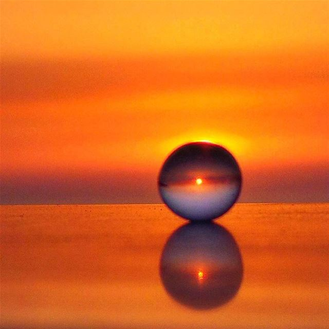 Sunset through a small ball ~~~~~~~~~~~~~~~ nikontop_  nikonworld ... (Radio voix du liban 93.3 - اذاعة صوت لبنان)