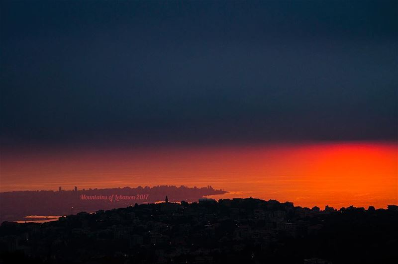 four layered sunset dark foreground of Ajaltoun, Orange background, Beirut... (Klay3at)