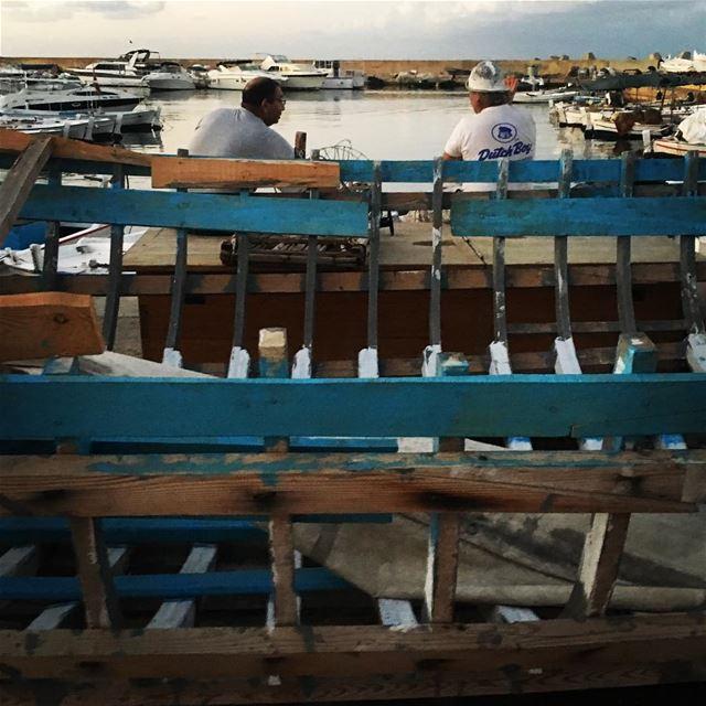 Friend's chat over the wreck arablife boat boatrepair port friendship... (Tyre, Lebanon)