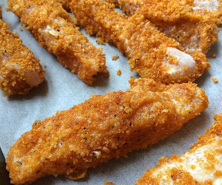 Corn flakes coated spicey chicken sticks to the oven for 15 minutes at...