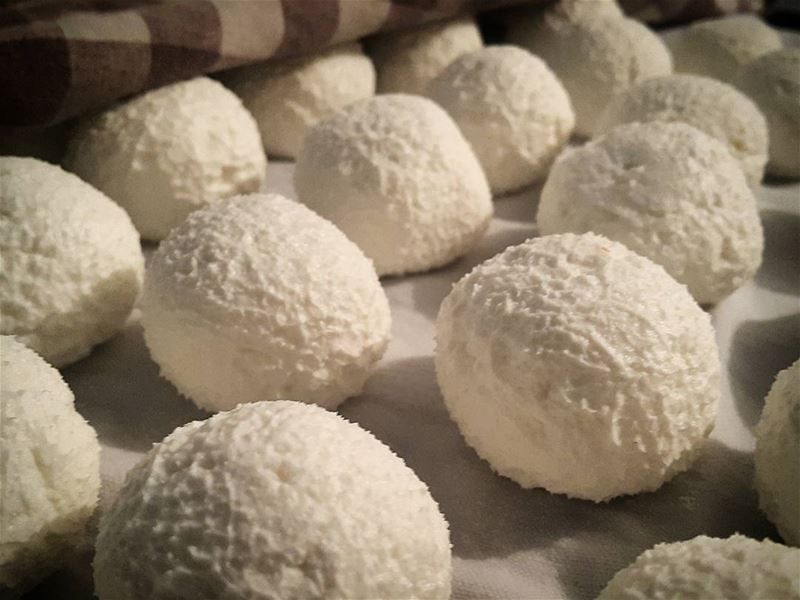 Fluffy homemade labneh in the making. Freshly rolled into balls after we...