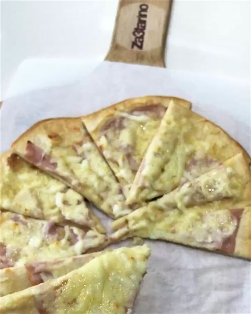 Tasty flatbread with ham and cheese. They make a delicious and tasty...