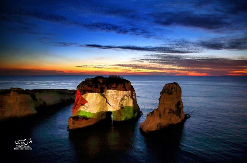 The landmark Raouche sea rock is illuminated by a giant Palestinian flag...