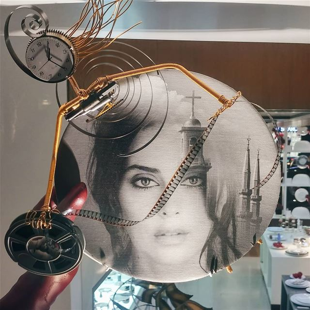 Au Gant Rouge sculpture showing @nadinelabaki face on a plate. A concept... (Beirut Souks)