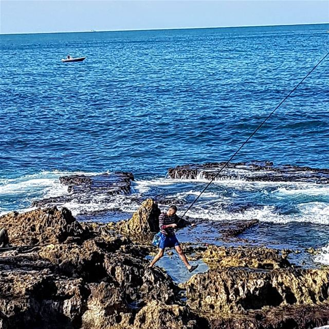 The Jumping Fisherman.  Beirut.. fishing  sun  sea  snow  lebanon ... (Beirut, Lebanon)