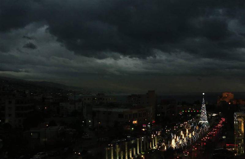black clouds above and holidaylights on the ground... thisislebanon79 ... (Byblos, Lebanon)