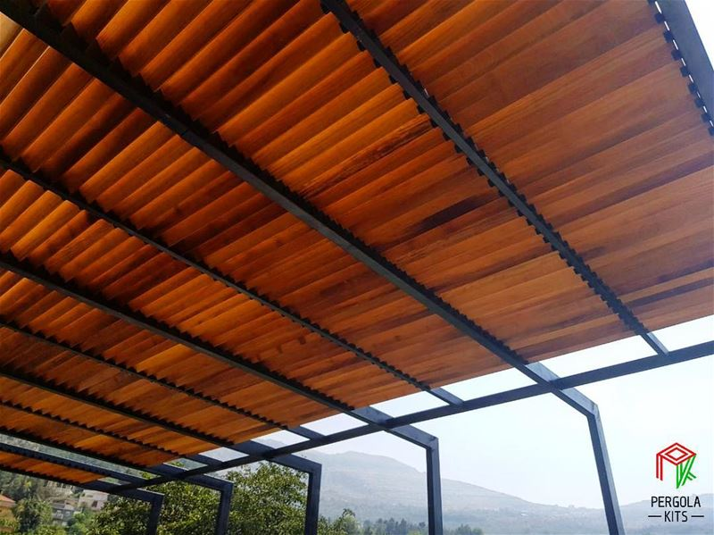 An Outdoor Space is made of Metal and Wood.  PergolaKitsLebanon. Pergola... (Toûla, Liban-Nord, Lebanon)