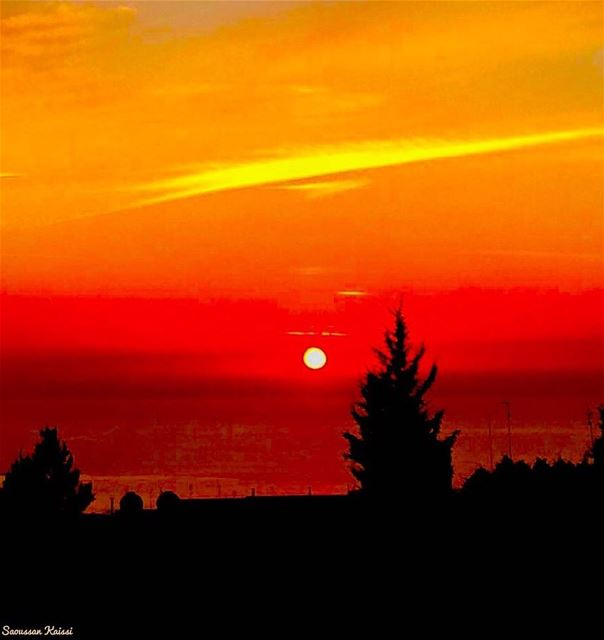sunset colors red black orange sea ...