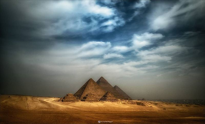 A dramatic rare view of the Pyramids of Giza in Egypt. Such an amazing... (The Pyramids Egypt)