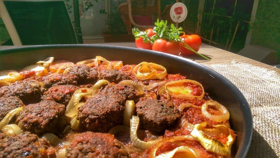 Kafta Bil Saniyeh and Kousa Bi Laban for lunch today at Em's. Give us a... (Em's cuisine)