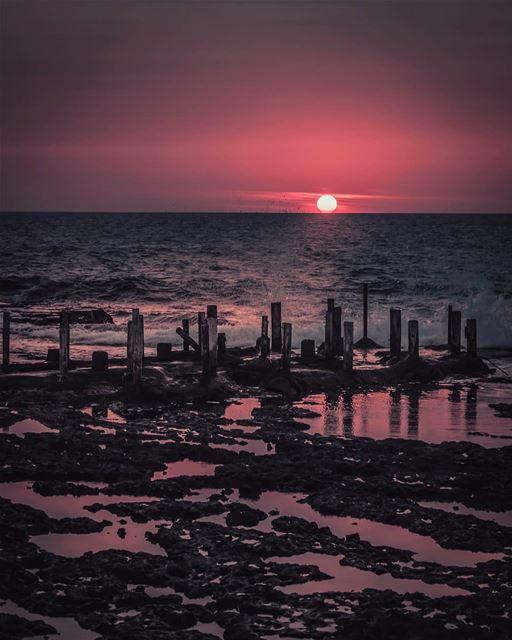 sunset poles sea sky clouds rocks byblos lebanon snapshot photo ... (Byblos, Lebanon)
