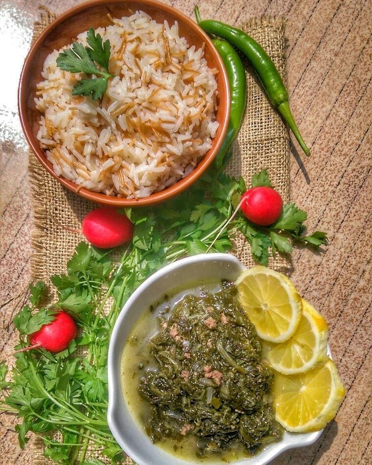 Spinach with Rice and Shawarma Chicken for lunch today at Em's. Give us a... (Em's cuisine)