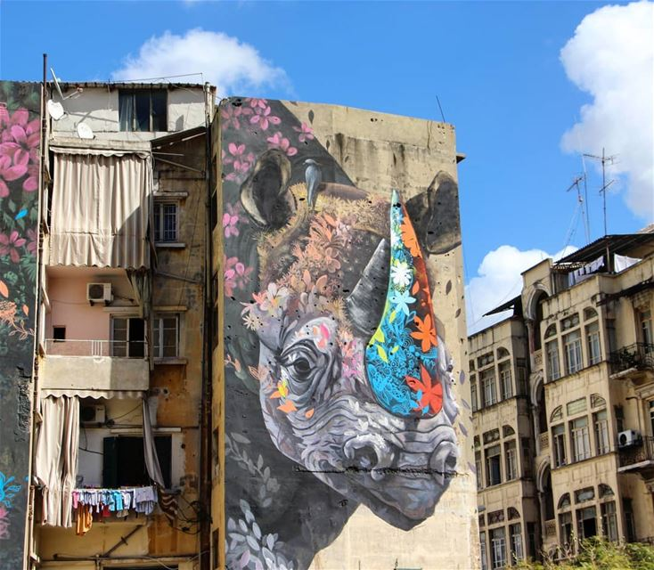 """The Rhino and the Oxpecker"" 🦏Amazing artwork by @ernestomaranje (Beirut, Lebanon)"