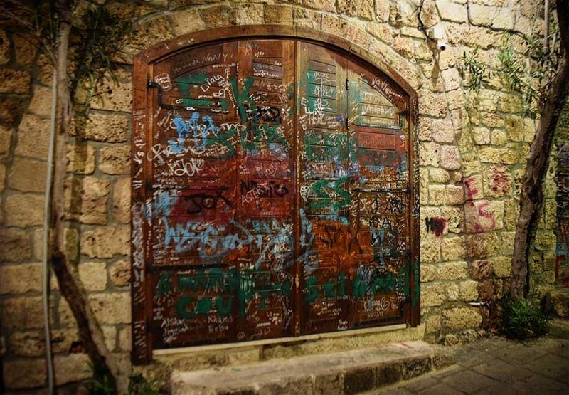 wall graffiti graffitiart byblos door night photography ... (Byblos - Jbeil)