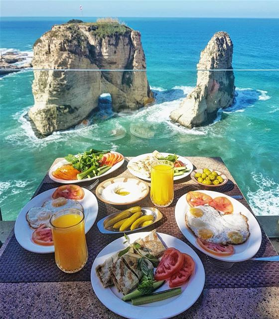 Breakfast with an Iconic view! 💙 Who's hungry? 😊By @framewithaview ... (Raouche Rock , Beirut , Lebanon)