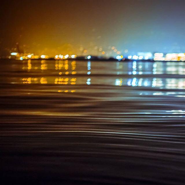 beirut city cityscape night light sea ripples water reflection ...