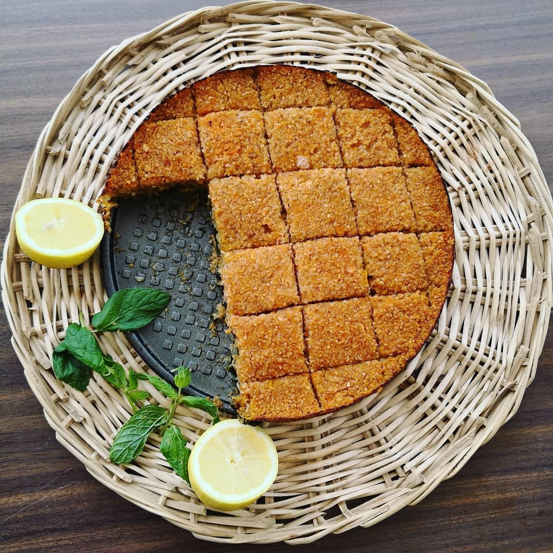 My favorite vegan pumpkin kibbeh in a tray with spinach kibbehbilsanieh... (Lebanon)
