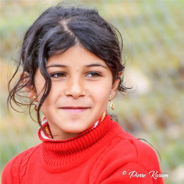beauty in the eyes posing little girl... village boys ...