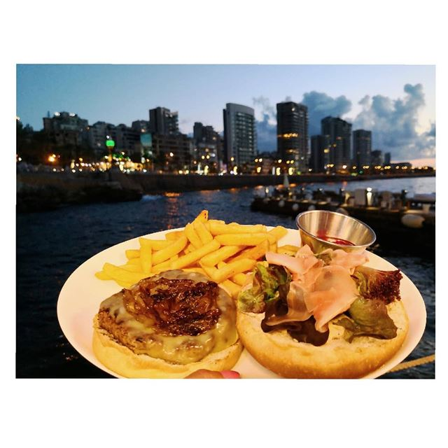 A burger? a view? What if both?! ❤️🍔 Burger Beirut Seasalt @diallaz 😉... (La Plage Beirut)