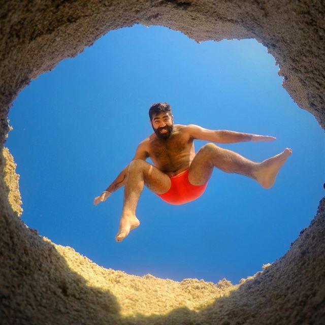 A Hole New World 🕳 jump fun hole legs sky summer beach beard air... (Bahr Sour)