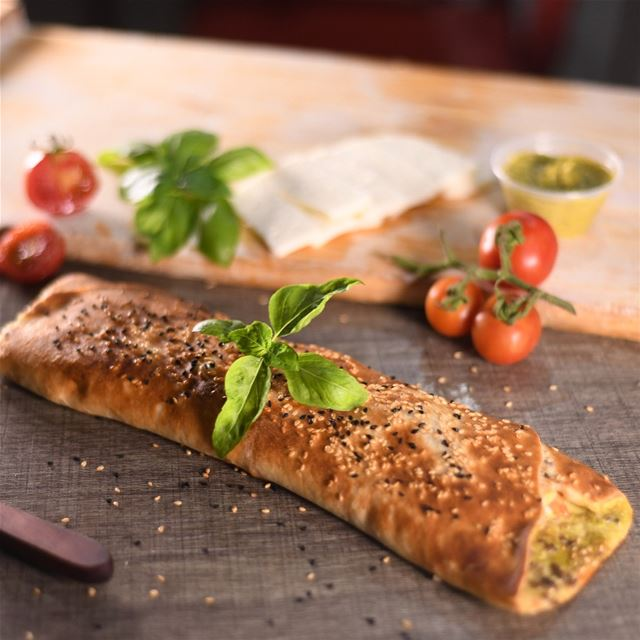 Our 2nd special item is our Halloumi Pesto rolled man2oushi grabbed with... (Rashet somsom - رشة سمسم)