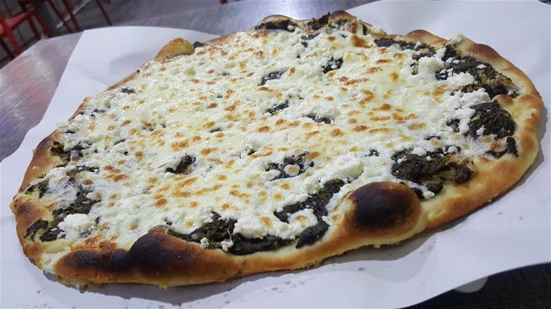 Fulfill your water-mouth with our special spinach man2oushi topped with... (Rashet somsom - رشة سمسم)