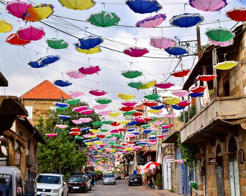 حصرون 🌸  وردة_الجبل  umbrellas  colors  colorful  oldhouses  redroof ... (Hasroun)