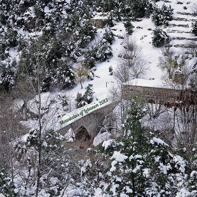 1/3 Winter snow covering both the watermill and the stone bridge in ... (وادي الصليب)