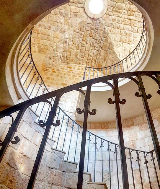 Looking up the beautiful stairs and wrought iron railings of the winery, a... (Ixir Winery)
