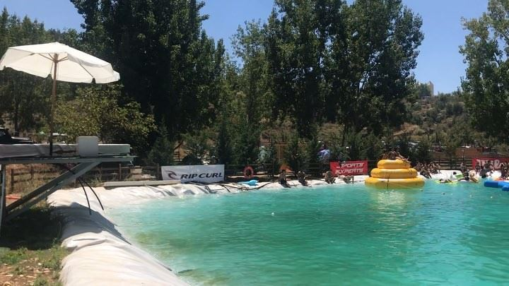Slide game on waterslide thefield pool nature mountains fun ... (The Field Lebanon)