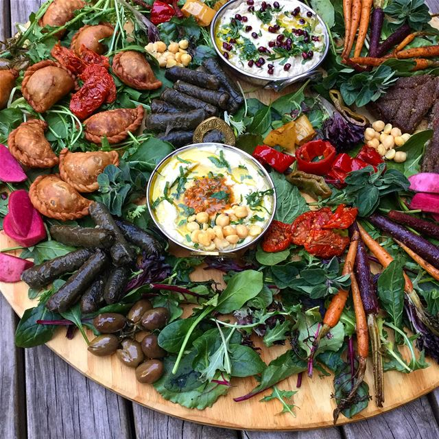 Up close and personal with this  hummus and  babaghanouj  platter we put...