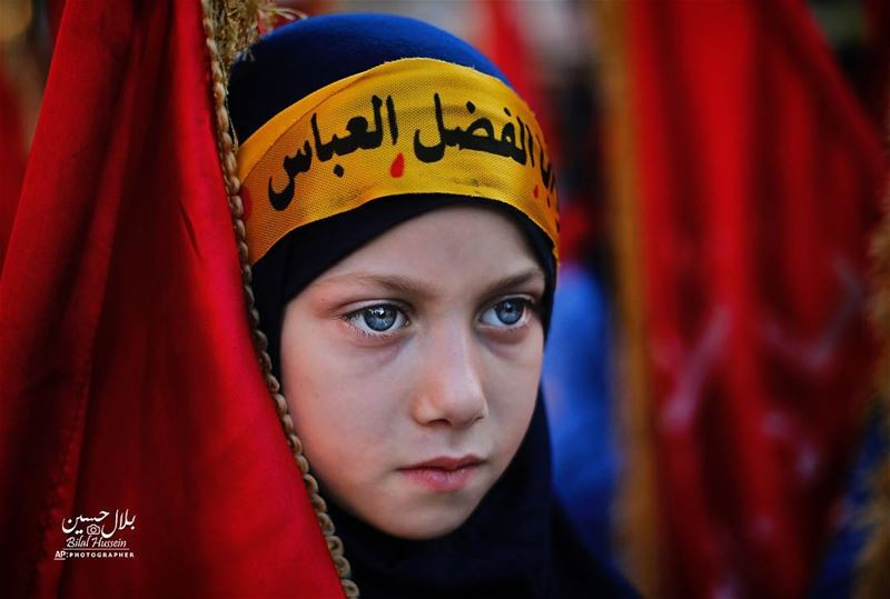 A Shiite Muslim girl attends activities marking the holy day of Ashoura,...