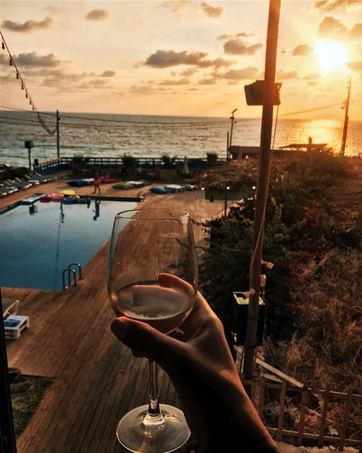 Happiness in a glass 🍷 batroun sunset wine drink lebanon beirut ... (Kfarabida Garden)