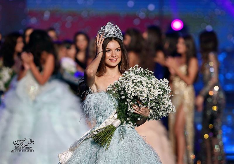 Lebanese Maya Reaidy, newly crowned Miss Lebanon, fixes her crown after...