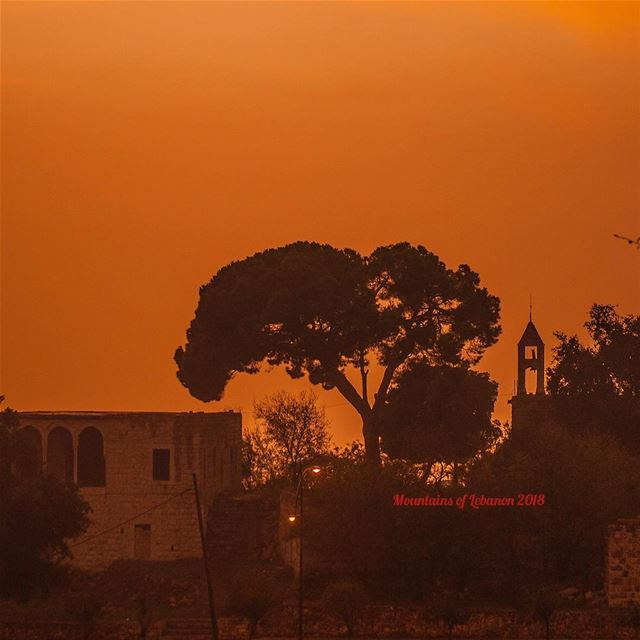 Rain or cloud before sunset turns the sky orange! over the bell tower of... (Ballouneh, Mont-Liban, Lebanon)