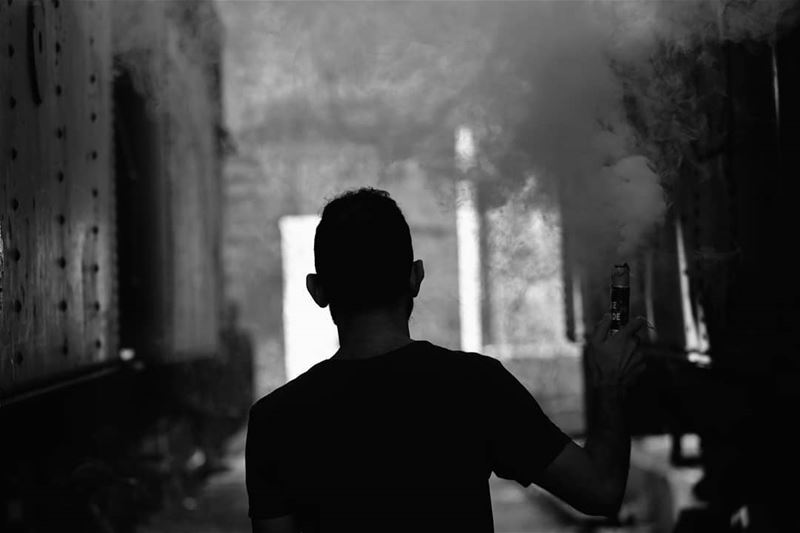 🇱🇧 Me in Black and White with smoke .Photo by @elierak ..  بيروت_مش_بشعة (Tripoli Train Station Terminal)