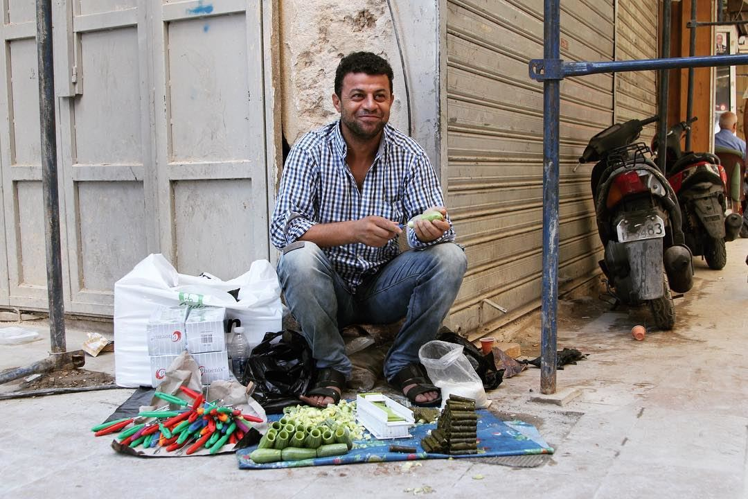 By the side of the road in Tripoli and also other places in Lebanon, men...