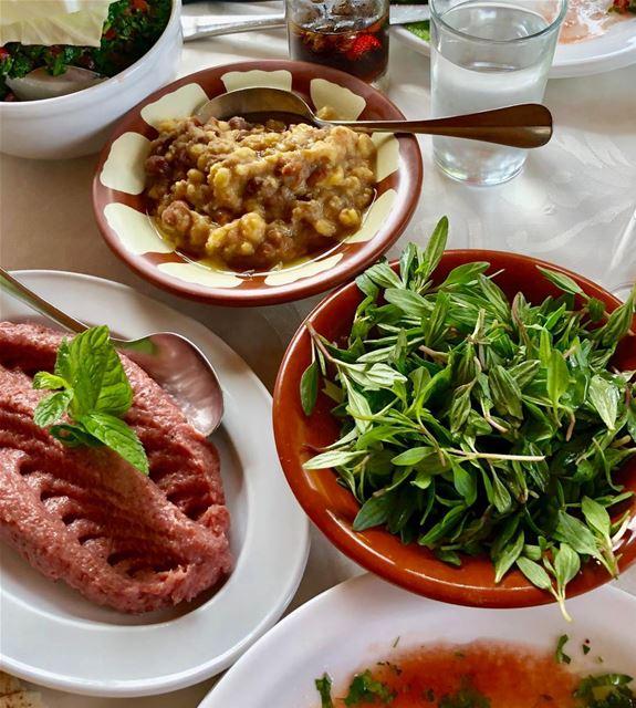 Kibbeh tartare aka nayyeh, fava beans aka fool, and green Zaatar. mezze ...