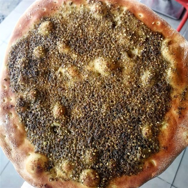 Plain or with veggies, zaatar man2oushe remains number 1 breakfast for... (Rashet somsom - رشة سمسم)