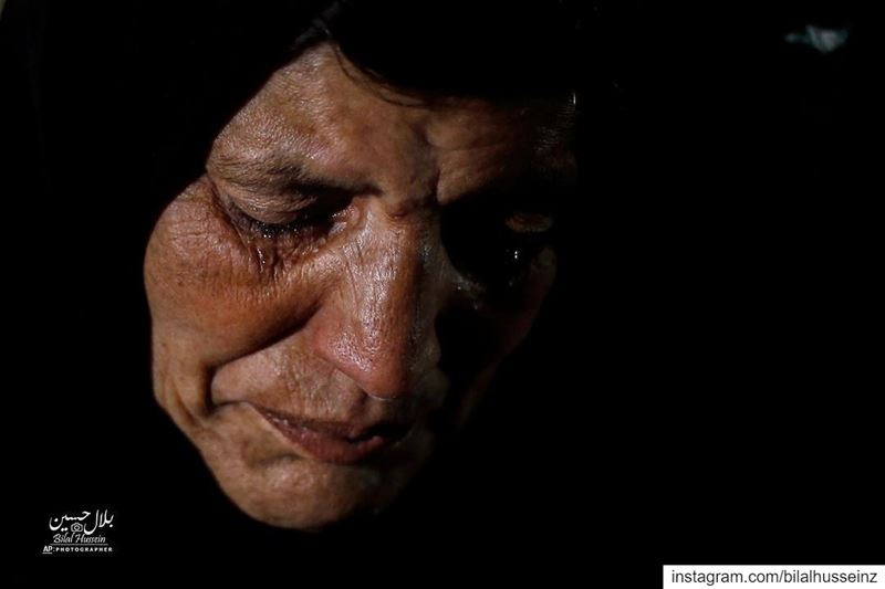 Syrian refugee Itihad Sayed weeps, in Ouzai refugee compound, in the...