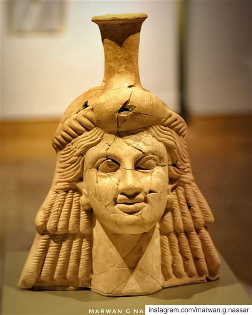 Vase representing a woman's head, with visible traces of white, brown,... (National Museum of Beirut)