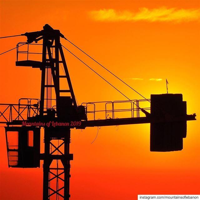 Crane hammering the sun! 🙄 cranes construction orangesunset ... (Beirut, Lebanon)