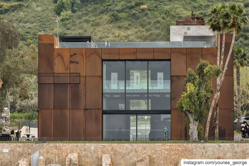 The rear side of the rust colored Nabu Museum in Chekka, North Lebanon...
