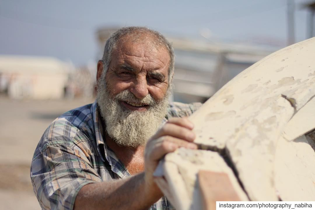 He is a carpenter, who fixes boats on Tripoli port. worker may1 ...